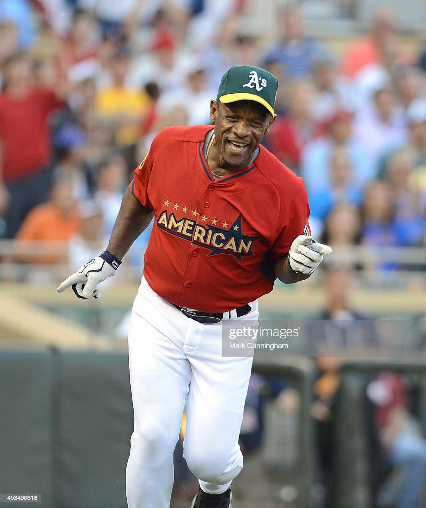 Former Major League Baseball player Rickey Henderson in action during the 2014 Taco Bell MLB All-Star Legends & Celebrity Softball Game at Target Field on July 13, 2014 in Minneapolis, Minnesota.