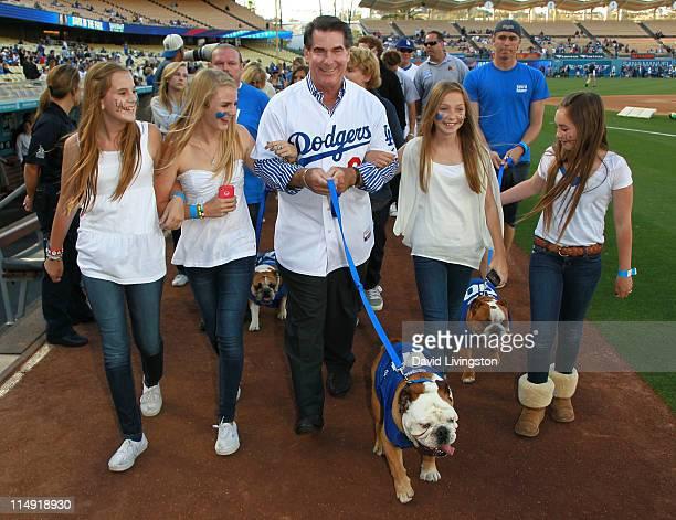 Former Major League Baseball player Steve Garvey walking Tillman the Skateboarding Dog attends the 2nd annual Bark in the Park at Dodgers' Stadium on...