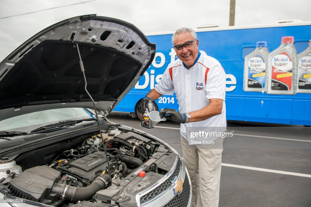 Former Major League pitcher Mike Torrez has a new position as part of Mobil Super 'Go the Distance' Baseball Tour August 23, 2014 at Advance Auto Parts in Roanoke, Virginia. Torrez joined the Mobil Super team to help change oil, meet fans and give away autographed baseballs and other prizes.