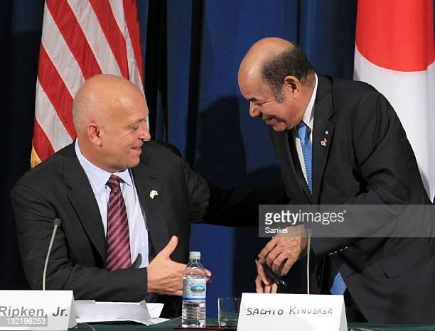 Former Major League player Cal Ripken Jr shakes hands with former baseball player Sachio Kinugasa during the press conference at the US Embassy on...