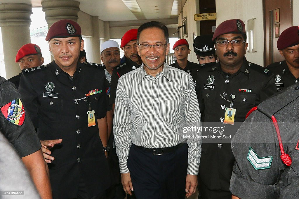 Former Malaysian opposition leader <a gi-track='captionPersonalityLinkClicked' href=/galleries/search?phrase=Anwar+Ibrahim&family=editorial&specificpeople=600601 ng-click='$event.stopPropagation()'>Anwar Ibrahim</a> arrives at court for the defamation suit hearing against his former tennis partner S. Nallakaruppan, on May 21, 2015 in Kuala Lumpur, Malaysia.
