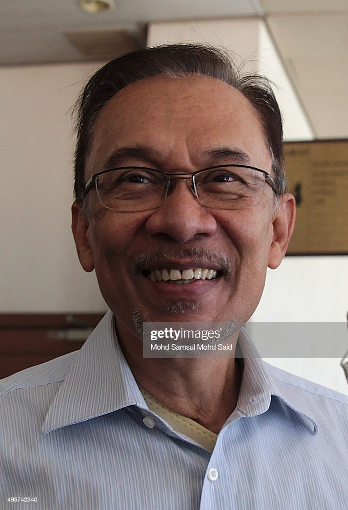 Former Malaysian opposition leader <a gi-track='captionPersonalityLinkClicked' href=/galleries/search?phrase=Anwar+Ibrahim&family=editorial&specificpeople=600601 ng-click='$event.stopPropagation()'>Anwar Ibrahim</a> smile as he arrive at courthouse on November 5, 2015 in Kuala Lumpur, Malaysia. <a gi-track='captionPersonalityLinkClicked' href=/galleries/search?phrase=Anwar+Ibrahim&family=editorial&specificpeople=600601 ng-click='$event.stopPropagation()'>Anwar Ibrahim</a> received five years in jail in February after being convicted for sodomising a male aide. The UN Working Group on Arbitrary Detention concluded that Anwar was denied a fair trial and that the charges were pursued for political reasons, according to the document released by the family.