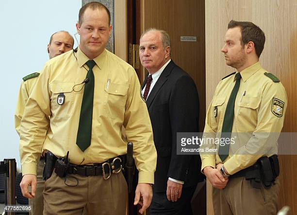 Former manager of Bayern Muenchen Uli Hoeness arrives escorted by police officers for his trial at the justice palace court room on March 10 2014 in...