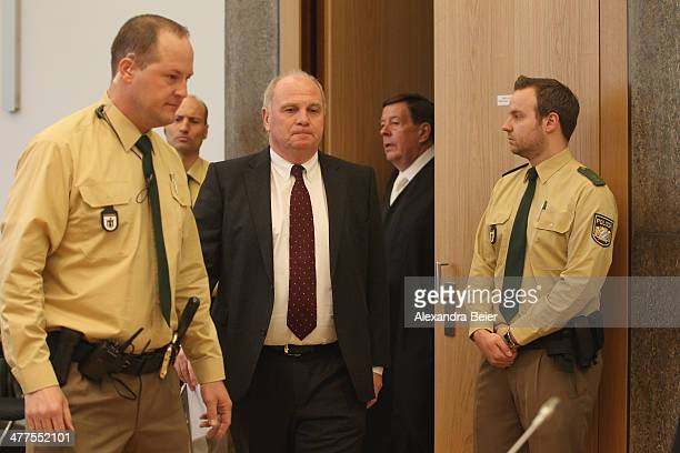 Former manager of Bayern Muenchen Uli Hoeness arrives for his trial escorted by police men and his lawyer Hanns W Feigen at the justice palace court...
