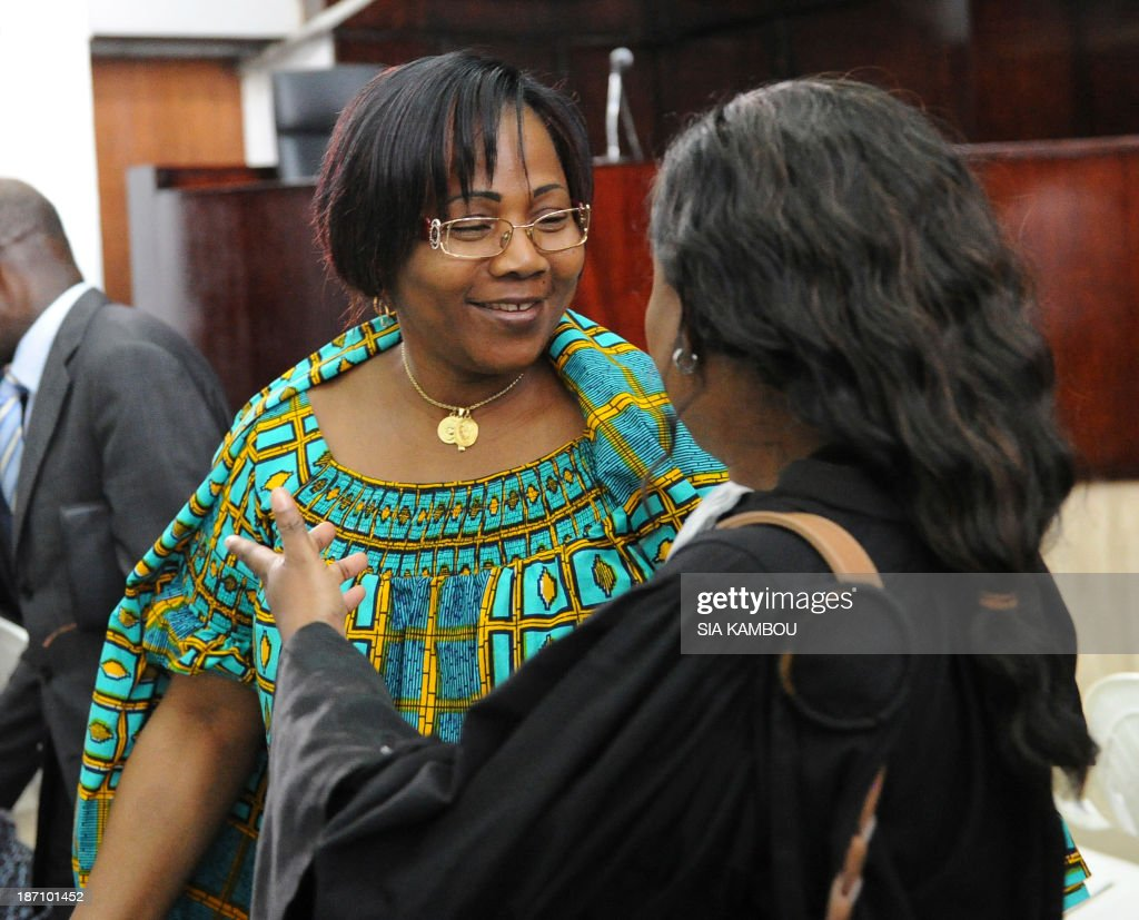 A former manager of the Ivorian cocoa industry, Angeline Zilahon Kili (L), speaks with her lawyer on November 6, 2013 at the Abidjan tribunal after being sentenced to 20 years in jail for misappropriation of corporate assets. Ivory Coast, the worlds biggest cocoa grower, sentenced 14 former managers of state-run cocoa agencies to 20 years in prison following the nations biggest probe into corruption in the industry. The defendants were found guilty of charges including misappropriation of corporate assets, embezzlement of public funds, breach of trust and fraud, Presiding Judge Hamed Coulibaly said.