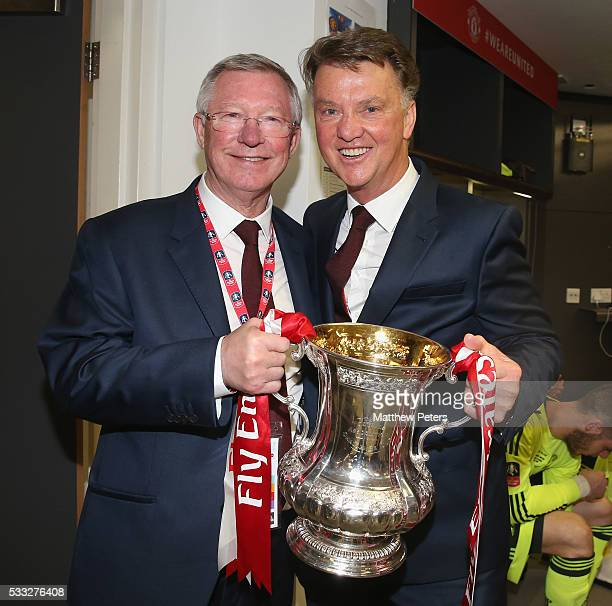 Former manager Sir Alex Ferguson and Manager Louis van Gaal of Manchester United celebrate with the FA Cup trophy after The Emirates FA Cup final...
