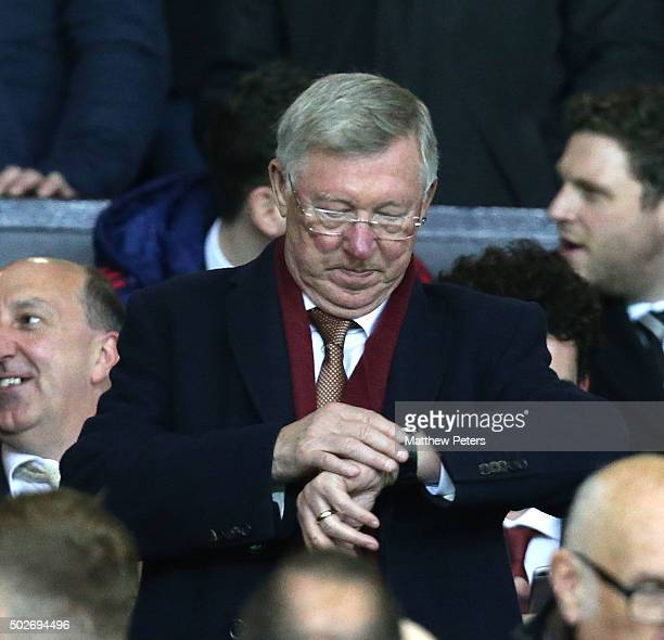 Former manager Sir Alex Ferguson checks his watch during the Barclays Premier League match between Manchester United and Chelsea at Old Trafford on...