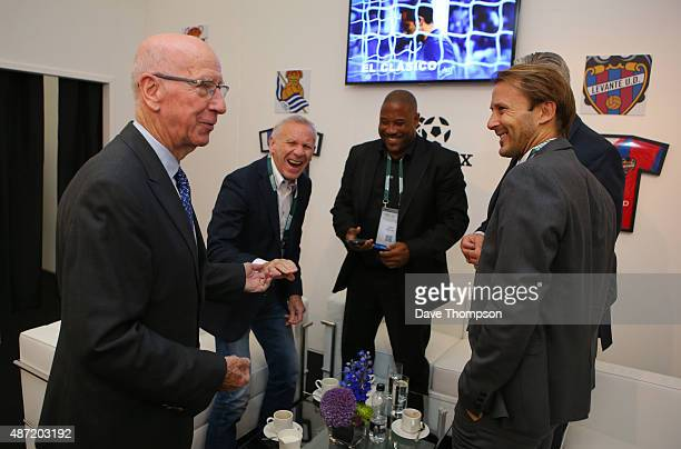 Former Manchester United and England footballer Sir Bobby Charlton left chats to former footballers Peter Reid John Barnes and Gaizka Mendieta right...