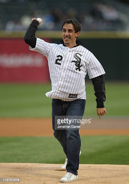 Former Manchester United captain Gary Neville throws a ceremonial first pitch before the Chicago White Sox take on the Oakland Athletics at US...