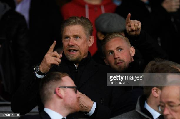 Former Manchester United Danish goalkeeper Peter Schmeichel and his son Danish Leicester City goalkeeper Kasper Schmeichel take their seat before the...