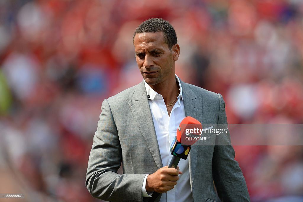 Former Manchester United defender Rio Ferdinand working as a Television pundit is pictured ahead of the English Premier League football match between...