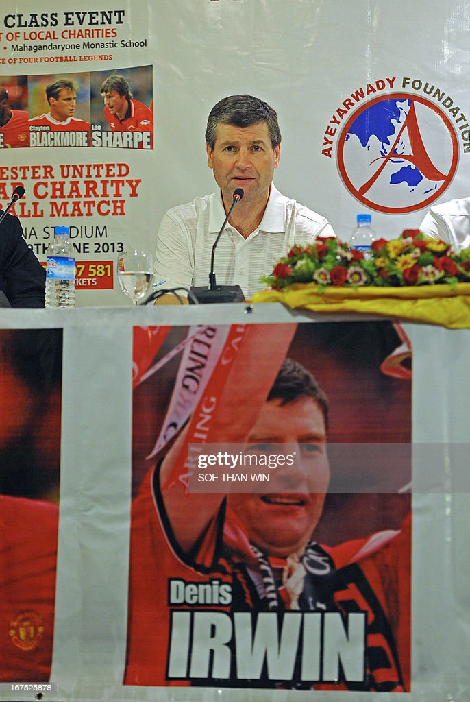 Former Manchester United football player Denis Irwin talks to the media during a press conference in Yangon on April 26, 2013. Former Manchester United players Denis Irwin, Andy Cole, Clayton Blackmore and Lee Sharpe will play in a charity football match in Yangon on June 9. AFP PHOTO / Soe Than WIN
