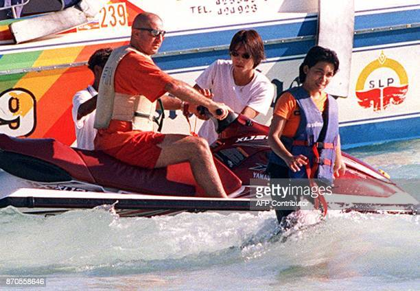 Former Manchester United football player Eric Cantona rides a jetski during a visit to Pattaya 09 May 2001 Cantona has reportedly threatend to pull...