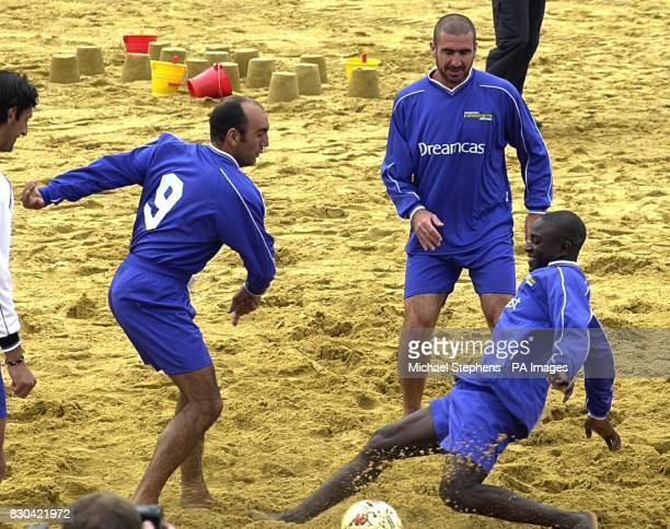 Former Manchester United football player Eric Cantona training with unidentified members of the team in Richmond for the inaugural Dreamcast Beach...
