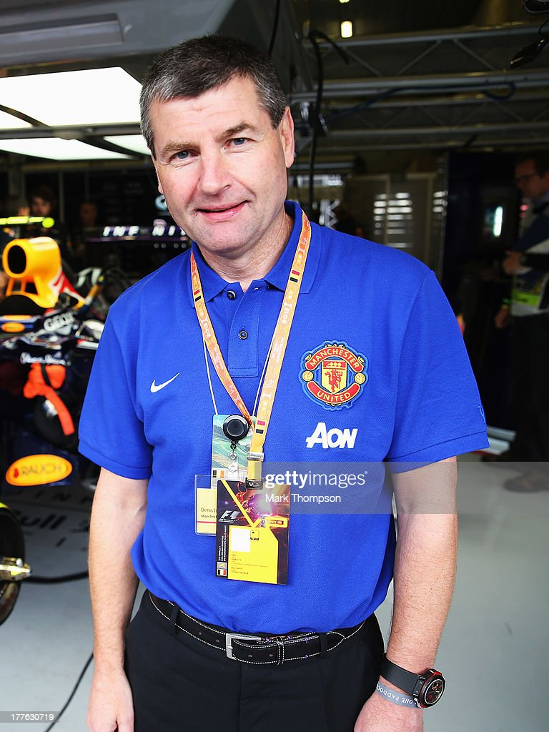 Former Manchester United footballer Dennis Irwin is seen in the Infiniti Red Bull Racing garage before the Belgian Grand Prix at Circuit de Spa-Francorchamps on August 25, 2013 in Spa, Belgium.
