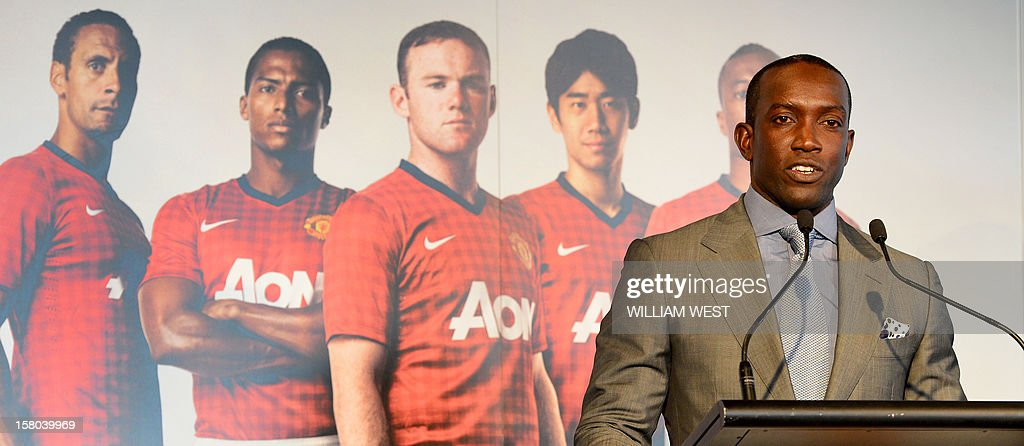 Former Manchester United footballer Dwight Yorke speaks at a press conference in Sydney on December 10, 2012, as it is announced English Premier League team Manchester United will play an Australian A-League All Stars team in a one-off game in 2013. The match at Sydney's Olympic stadium on July 20, 2013 will be United's first match Down Under in 14 years and will be part of their build-up to the 2013/14 season. AFP PHOTO/William WEST