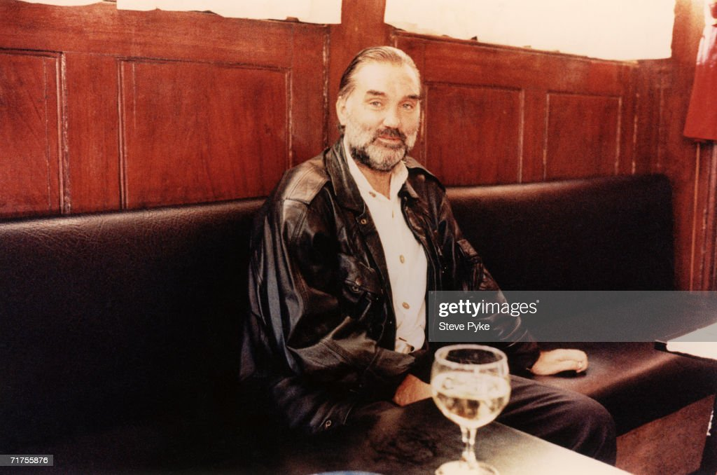 Former Manchester United footballer <a gi-track='captionPersonalityLinkClicked' href=/galleries/search?phrase=George+Best&family=editorial&specificpeople=206235 ng-click='$event.stopPropagation()'>George Best</a> (1946 - 2005) in a bar, circa 2000.