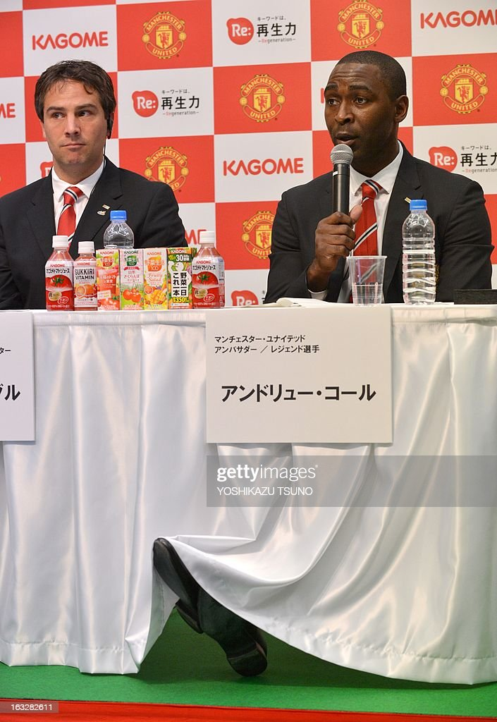 Former Manchester United forward Andy Cole (R) speaks while Manchester United Asia Pacific Director Jamie Reigle (L) listens at a press conference in Tokyo on March 7, 2013. Cole will foin Manchester United and Japanese food company Kagome during a football clinic for Japanese children living in the earthquake and tsunami stricken Tohoku region later this month. Manchester United will play a pre-season game against Japan's Yokohama F Marinos in Yokohama in July. AFP PHOTO / Yoshikazu TSUNO