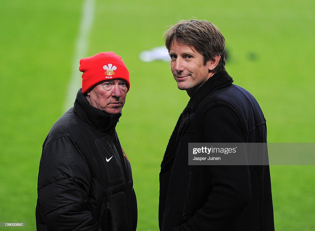 Former Manchester United goalkeeper Edwin van der Sar (R) chats with Sir <a gi-track='captionPersonalityLinkClicked' href=/galleries/search?phrase=Alex+Ferguson&family=editorial&specificpeople=203067 ng-click='$event.stopPropagation()'>Alex Ferguson</a> manager of Manchester United during a training session on the eve of the Europa League match between Ajax and Manchester United at Amsterdam Arena on February 15, 2012 in Amsterdam, Netherlands.