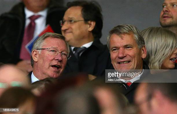 Former Manchester United Manager Sir Alex Ferguson chats to former United Chief Executive David Gill during the UEFA Champions League Group A match...