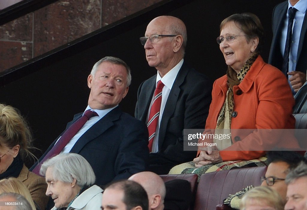 Former Manchester United manager Sir <a gi-track='captionPersonalityLinkClicked' href=/galleries/search?phrase=Alex+Ferguson&family=editorial&specificpeople=203067 ng-click='$event.stopPropagation()'>Alex Ferguson</a> sits with Sir <a gi-track='captionPersonalityLinkClicked' href=/galleries/search?phrase=Bobby+Charlton&family=editorial&specificpeople=204207 ng-click='$event.stopPropagation()'>Bobby Charlton</a> and his wife Norma during the Barclays Premier League match between Manchester United and Crystal Palace at Old Trafford on September 14, 2013 in Manchester, England.