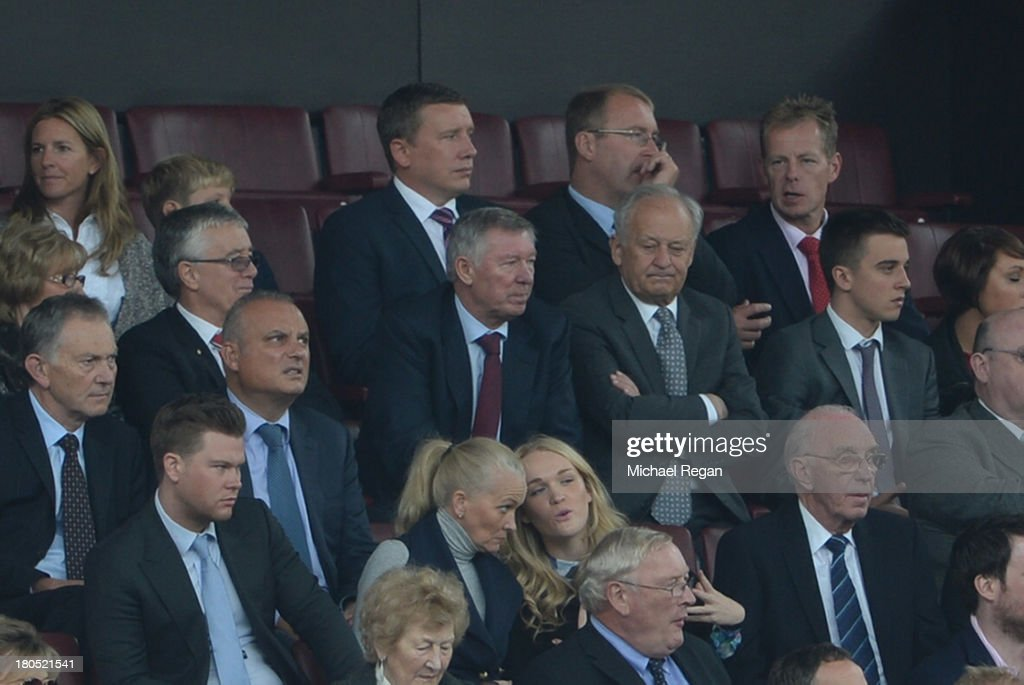 Former Manchester United manager Sir Alex Ferguson watches during the Barclays Premier League match between Manchester United and Crystal Palace at Old Trafford on September 14, 2013 in Manchester, England.