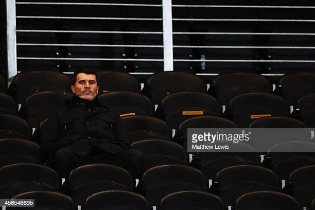 Former Manchester United player and football pundit Roy Keane waits for the start of the Barclays Premier League match between Hull City and Stoke...
