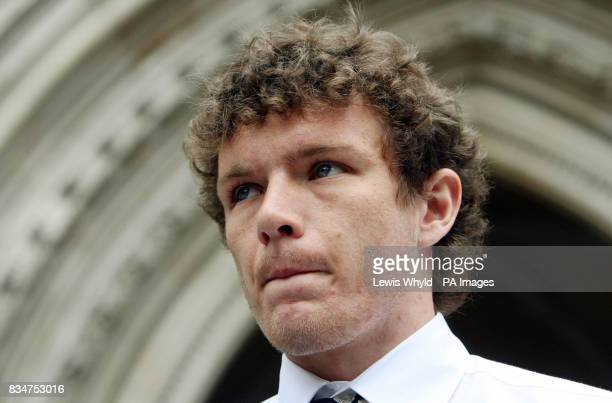 Former Manchester United player Ben Collett leaves the High Court in London after being awarded more than 43 million in compensation after his leg...