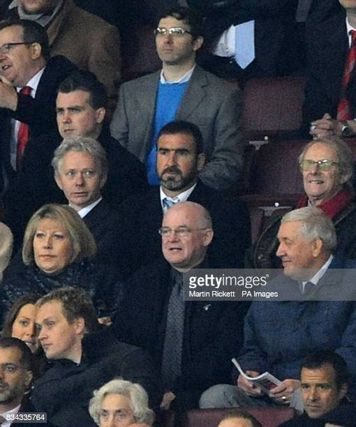 Former Manchester United player Eric Cantona watches from the stands during the UEFA Champions League Quarter Final Second Leg match at Old Trafford...
