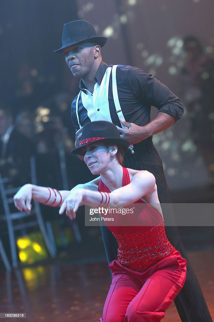Former Manchester United player Quinton Fortune performs a ballroom dancing routine as part of Dancing with United, in aid of the Manchester United Foundation, at Old Trafford on March 7, 2013 in Manchester, England.