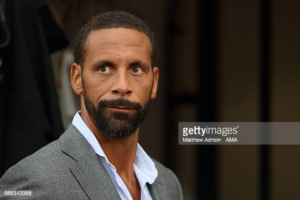 Former Manchester United player Rio Ferdinand working for TV Broadcaster BT Sport during the Wayne Rooney Testimonial match between Manchester United...