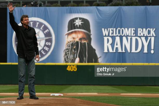 Former Mariners star Randy Johnson waves to the crowd prior to throwing out the ceremonial first pitch before the Mariners' home opener against the...