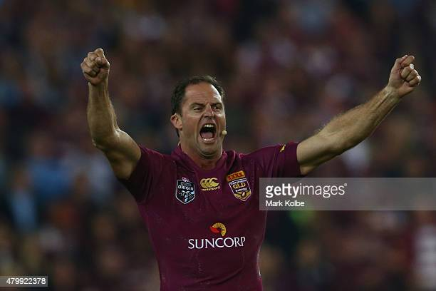 Former Maroons player Billy Moore leads the crowd in a Queenslaner chant during game three of the State of Origin series between the Queensland...