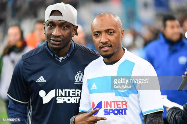 Former Marseille player Mamadou Niang and French rapper Soprano during the French Ligue 1 match Marseille and Paris Saint Germain at Stade Velodrome...