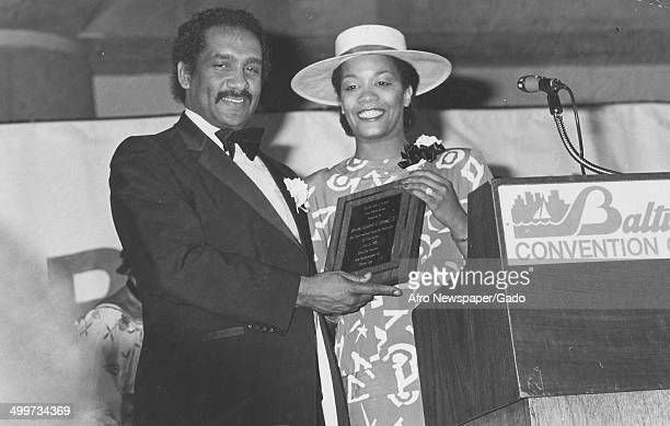 Former Maryland State Senator Clarence Mitchell III and Afro American Newspapers employee Bonnie Butler holding the Carl Murphy award at Baltimore...