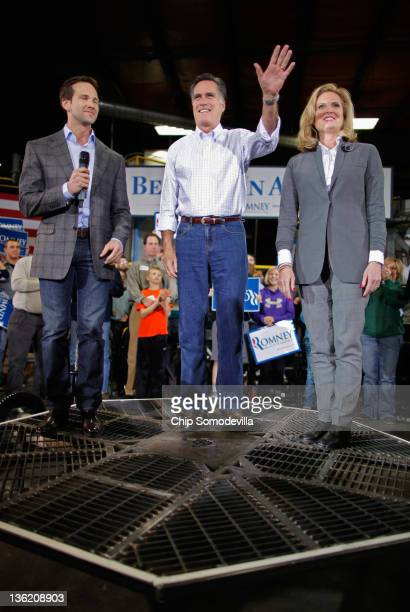 Former Massachusetts Governor and Republican presidential candidate Mitt Romney his wife Ann Romney and US Rep Aaron Schock stand on a piece of...