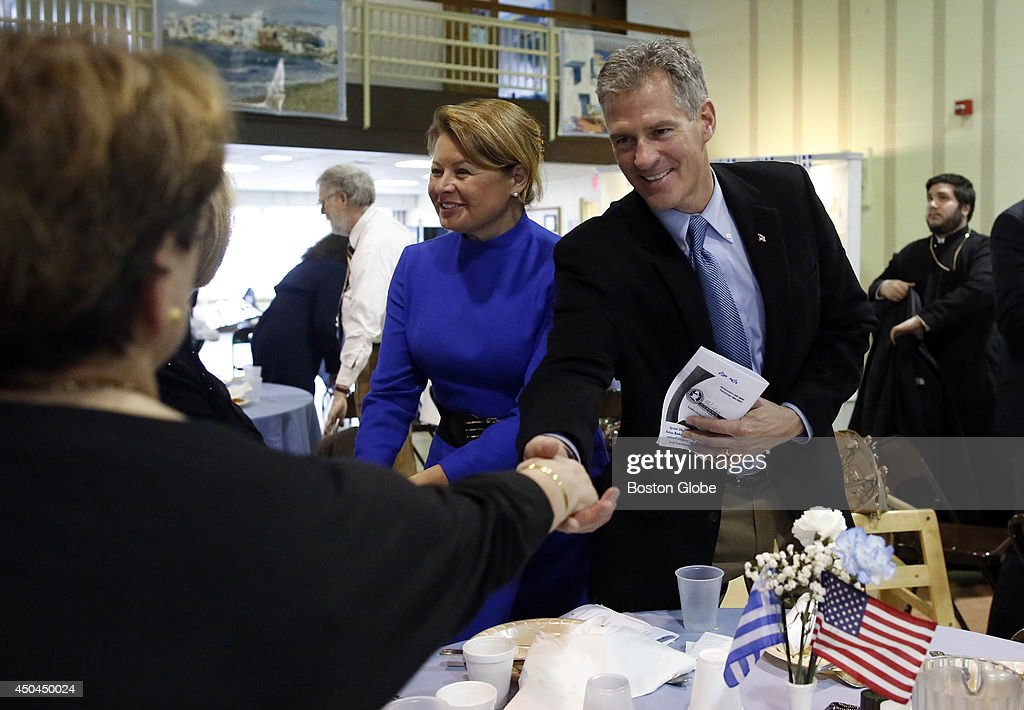 Former Massachusetts Senator Scott Brown and his wife, Gail Huff, left, bid farewell to fellow attendees at the conclusion of the 4th Annual Greek Independence Day Celebration in Manchester, New Hampshire on March 30, 2014.