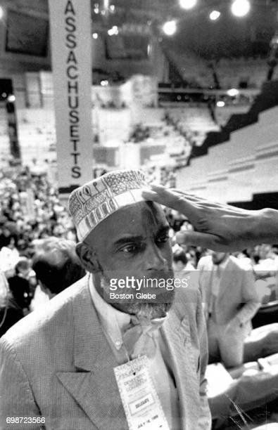 Former Massachusetts State Representative Mel King has a friend adjust his hat at the opening of the Democratic National Convention in Atlanta GA on...