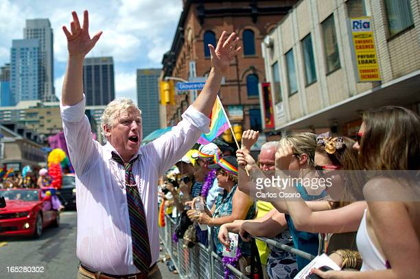 Former Mayor David Miller Party goers march in the annual Pride Parade in Toronto on July 3 2011