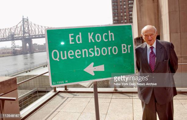 Former mayor Ed Koch stands next to the newly renamed 'Ed Koch Queensboro Bridge' sign Koch said he always dreamed something grand would be named for...