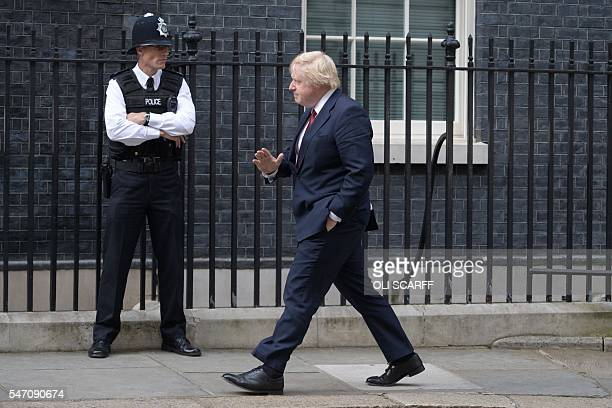 Former mayor of London Boris Johnson walks to 10 Downing Street in central London on July 13 2016 after New British Prime Minister Theresa May takes...