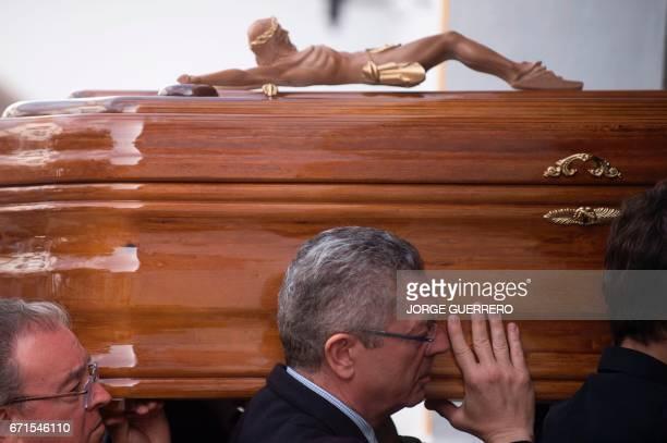 Former mayor of Madrid Alberto Ruiz Gallardon carries the coffin with the body of former Franco minister Jose Utrera Molina in Nerja on April 22 2017...