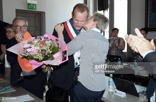 Former mayor of MontdeMarsan and newly appointed Junior Minister for Defence Genevieve Darrieussecq kisses the new Mayor of MontdeMarsan Charles...