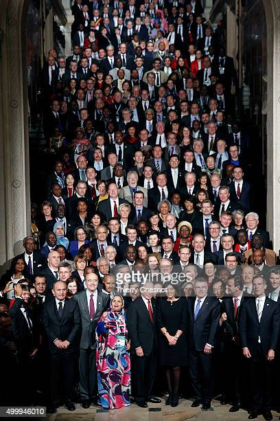 Former Mayor of New York City Michael Bloomberg and Mayor of Paris Anne Hidalgo pose with thousand mayors from different cities at the Paris city...