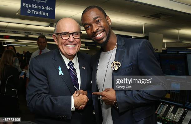 Former Mayor of New York City Rudy Giuliani and football plater Victor Cruz attend the annual Charity Day hosted by Cantor Fitzgerald and BGC at...