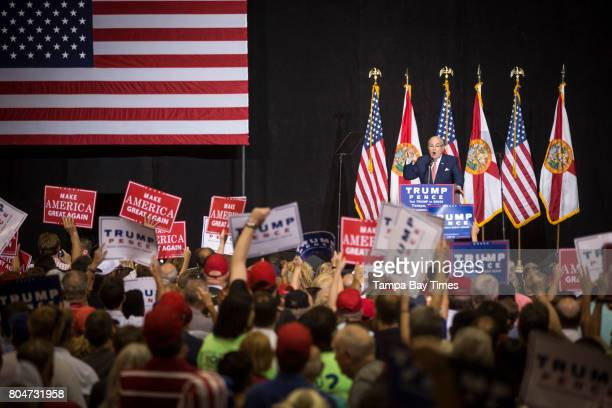 Former Mayor of New York City Rudy Giuliani greets Republican presidential nominee Donald Trump just after introducing him at a rally at the Florida...