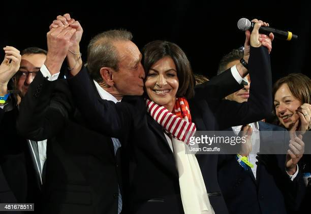 Former Mayor of Paris Bertrand Delanoe and his newlyelected successor Anne Hidalgo celebrate the victory at City Hall plaza on March 30 2014 in Paris...