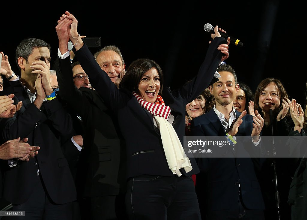 Former Mayor of Paris Bertrand Delanoe and his newly-elected successor <a gi-track='captionPersonalityLinkClicked' href=/galleries/search?phrase=Anne+Hidalgo&family=editorial&specificpeople=590989 ng-click='$event.stopPropagation()'>Anne Hidalgo</a> celebrate the victory at City Hall plaza on March 30, 2014 in Paris, France.