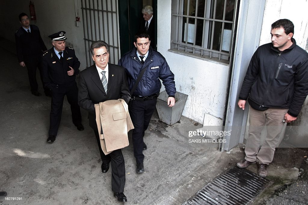 Former Mayor of the Greek northern port city of Thessaloniki Vassilis Papageorgopoulos (L) is escorted to prison in Thessaloniki on February, 27, 2013. A court in Thessaloniki, northern Greece today convicted the city's ex-mayor and three other municipal officials in a decade-long embezzlement case, local officials said. Papageorgopoulos, 65, was handed a life sentence for turning a blind eye to the embezzlement of nearly 18 million euros ($23.5 million) from municipal coffers between 1999 and 2008. AFP PHOTO /Sakis Mitrolidis