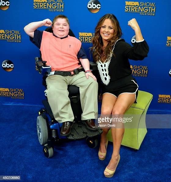 Former MDA spokesman Bryson Foster and Recording Artist Sara Evans film a commercial at Grand Ole Opry House on June 6 2014 in Nashville Tennessee